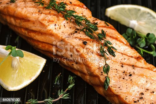 Grilled salmon closeup with lemon and thyme