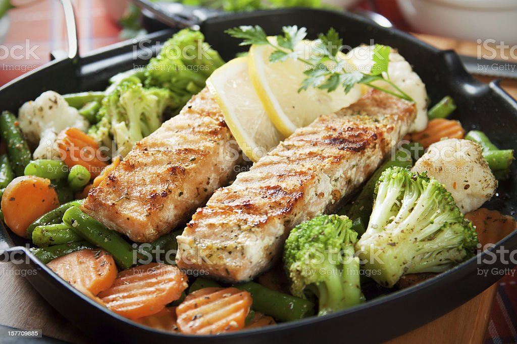Grilled salmon steak and vegetables royalty-free stock photo