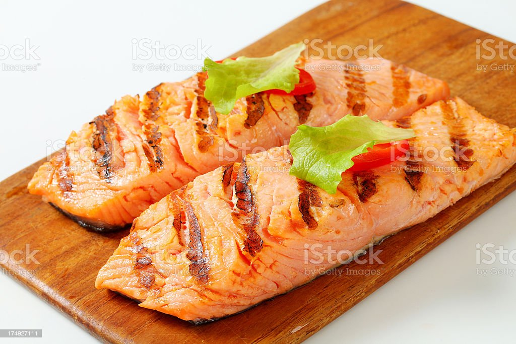 Grilled salmon steak on a cutting board royalty-free stock photo