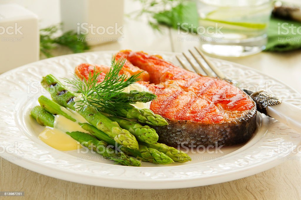 Grilled salmon steak with asparagus. stock photo