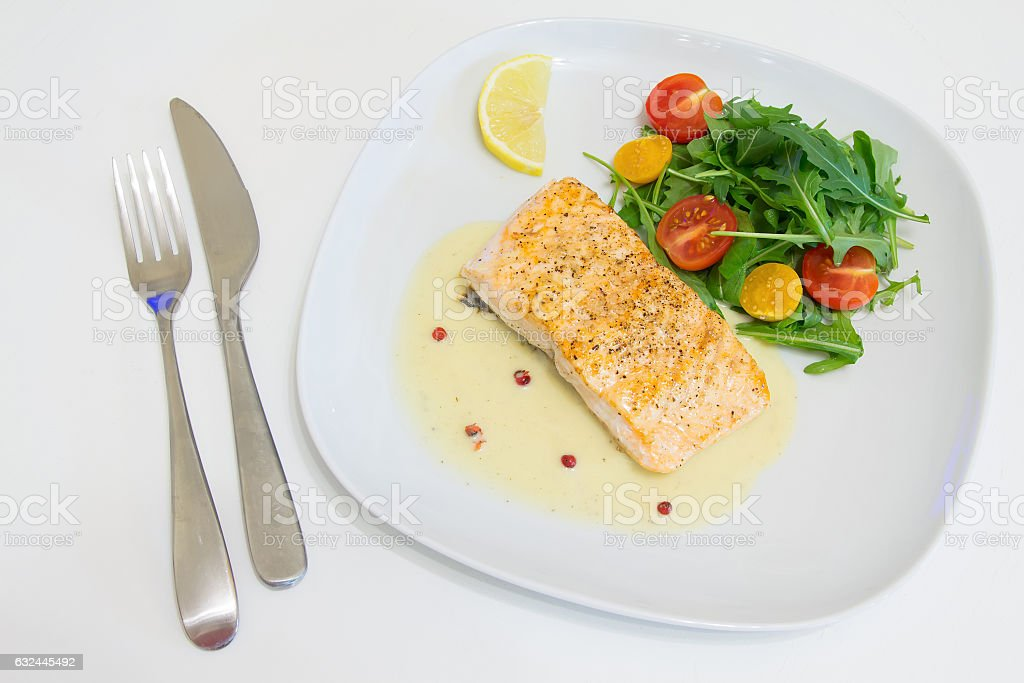 Grilled salmon steak with beurre blanc sauce stock photo