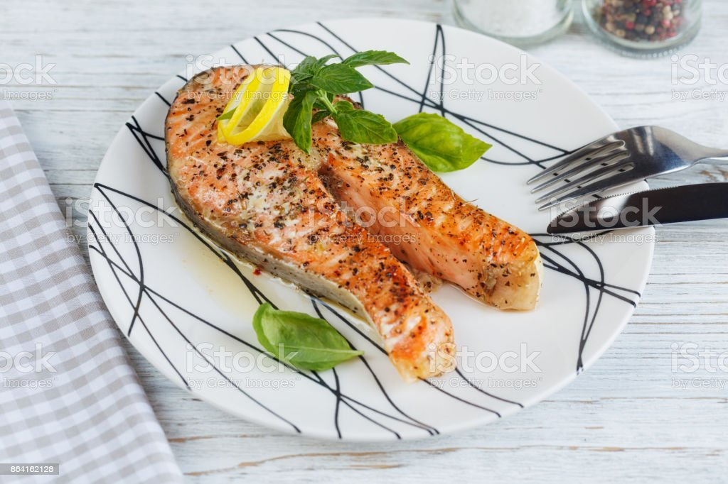 Grilled Salmon steak with lemon and herbs. royalty-free stock photo