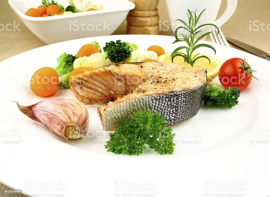 Grilled salmon steak with vegetables royalty-free stock photo