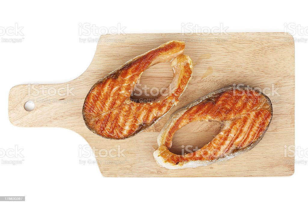 Grilled salmon steaks on cutting board royalty-free stock photo