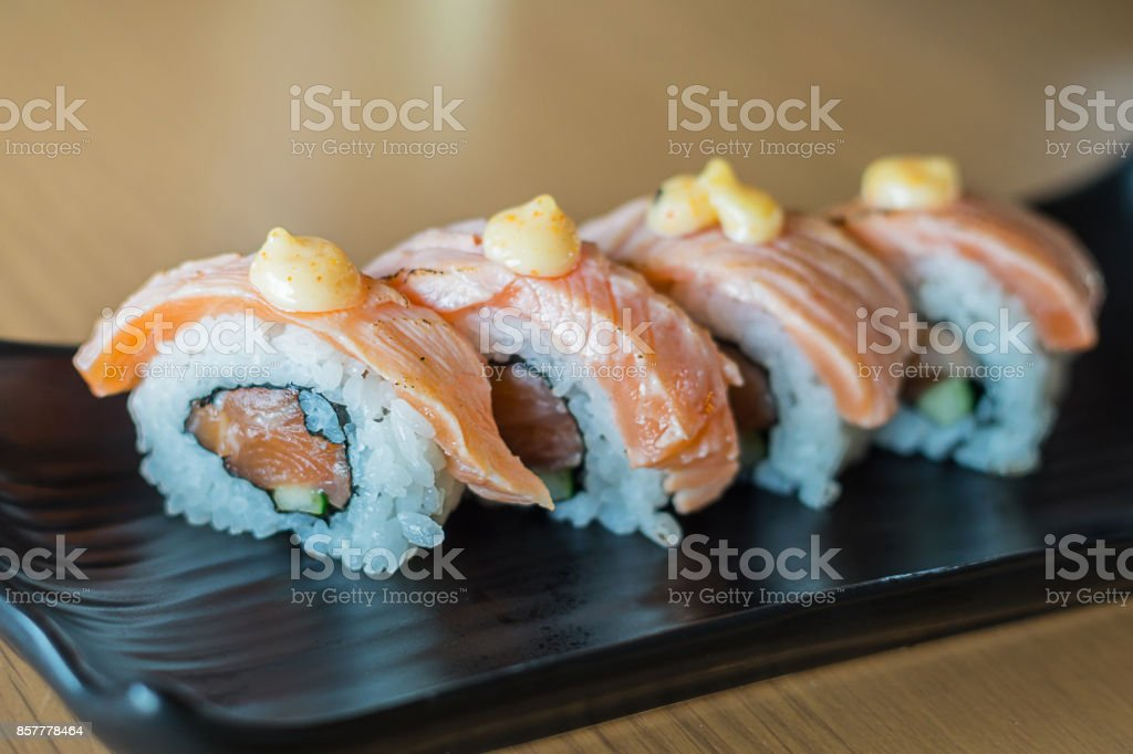 Grilled Salmon Sushi Roll Japanese Food Style On Black Ceramic Dish Stock Photo Download Image Now Istock