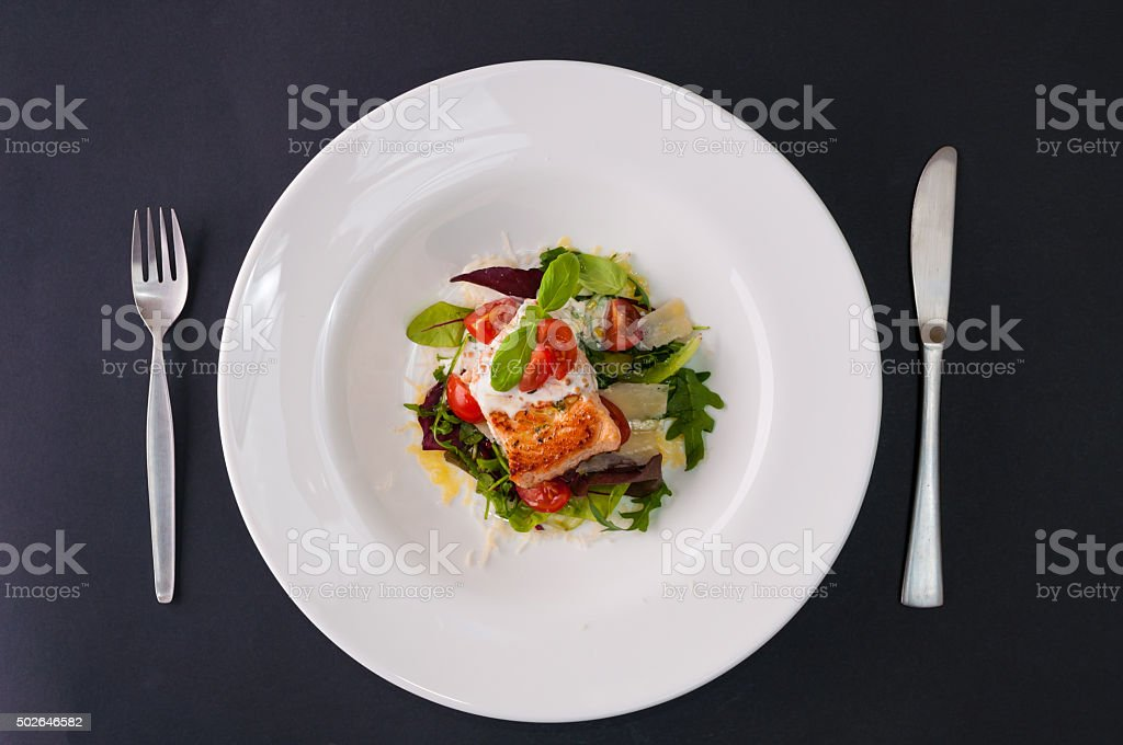 Grilled salmon whit salad stock photo