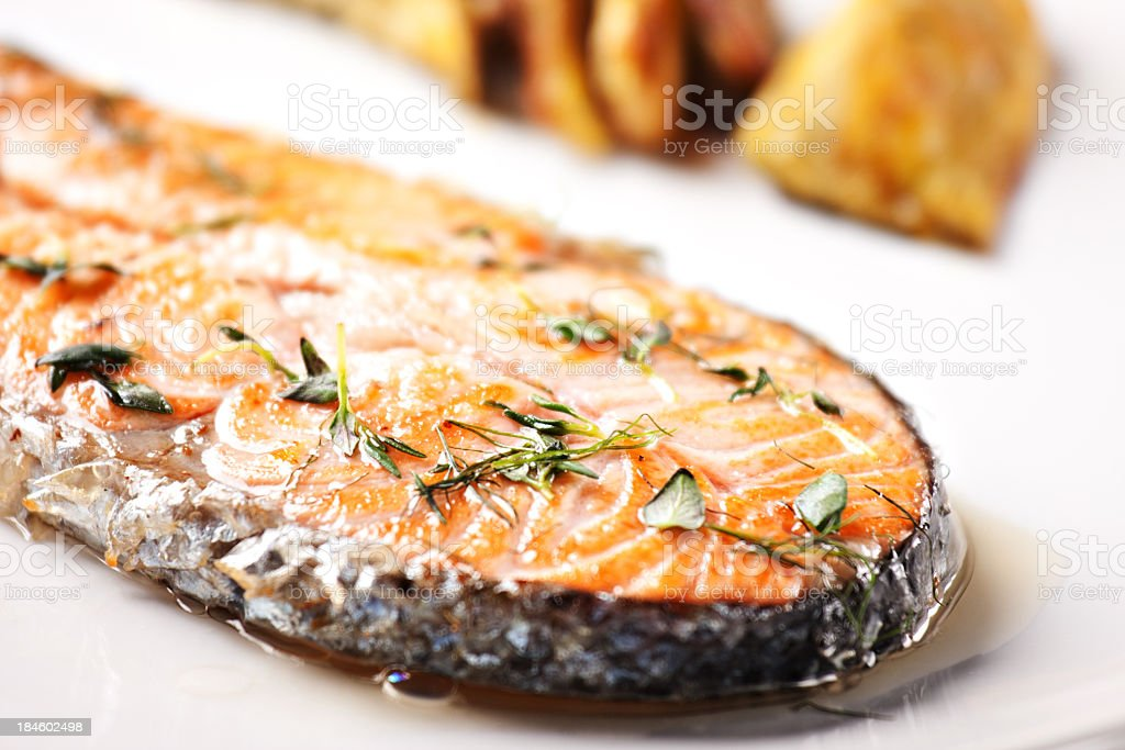 Grilled Salmon with artichokes. royalty-free stock photo