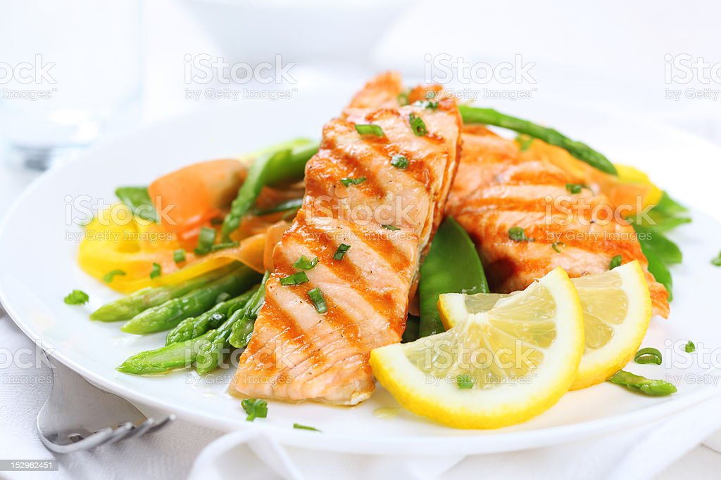 grilled salmon with asparagus  on white plate stock photo