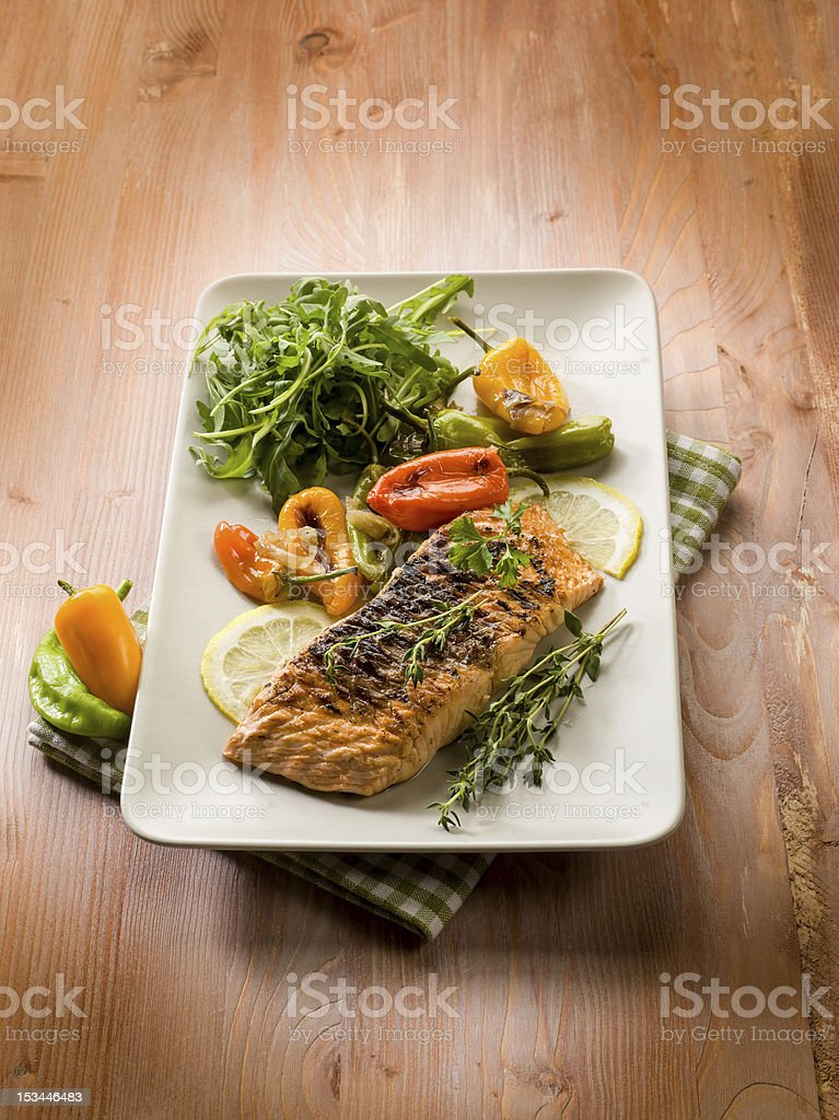 grilled salmon with capsicum and arugula royalty-free stock photo