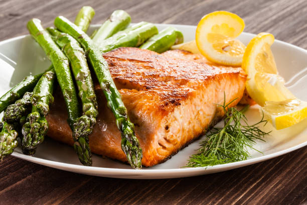 Grilled salmon with French fries and asparagus Grilled salmon with French fries and asparagus dill stock pictures, royalty-free photos & images