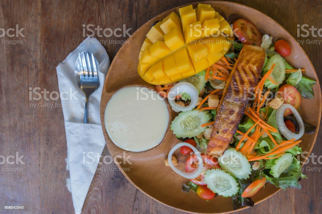 Grilled Salmon with fresh salad and mango fruit. stock photo