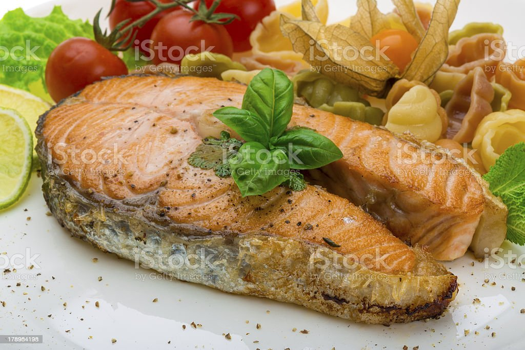 Grilled salmon with pasta royalty-free stock photo