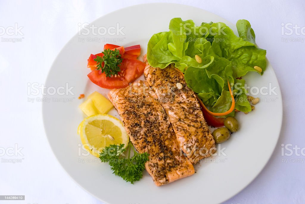 Grilled Salmon with Salad and Olives royalty-free stock photo