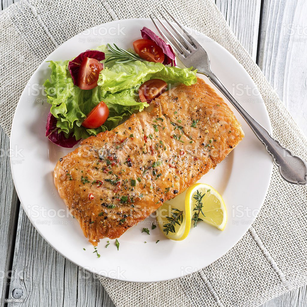 Grilled salmon with salad stock photo