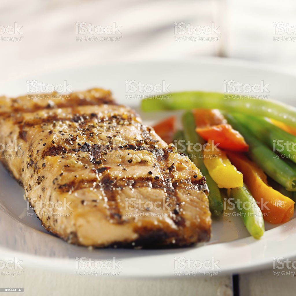 grilled salmon with vegetables close up royalty-free stock photo