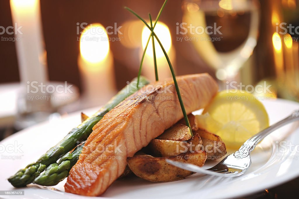Grilled salmon with vegetables royalty-free stock photo