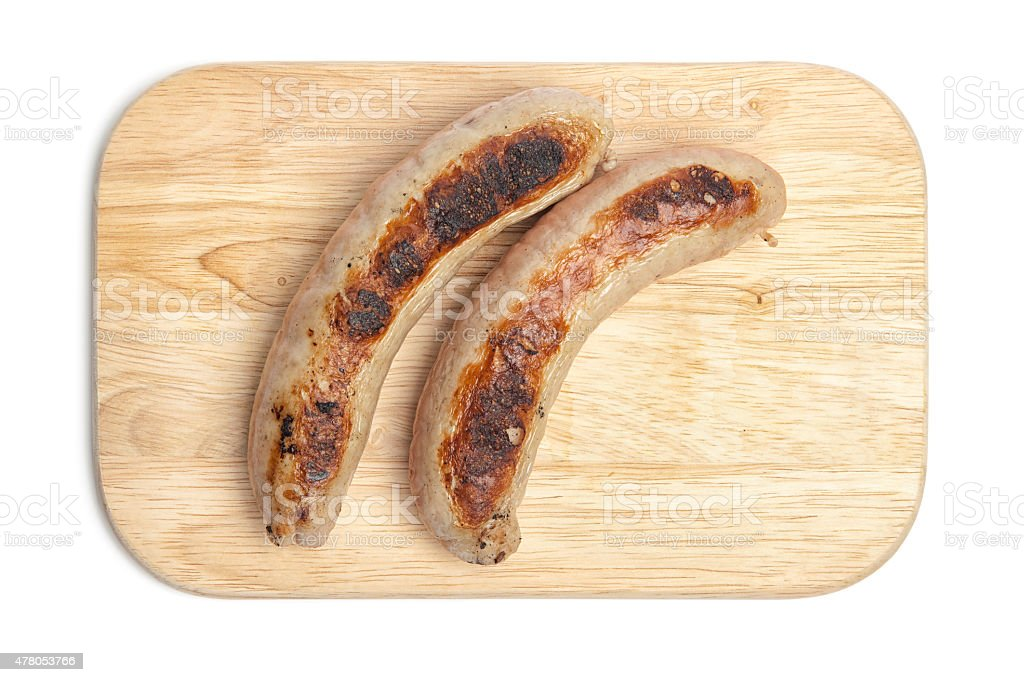 Grilled sausage on chopping board stock photo