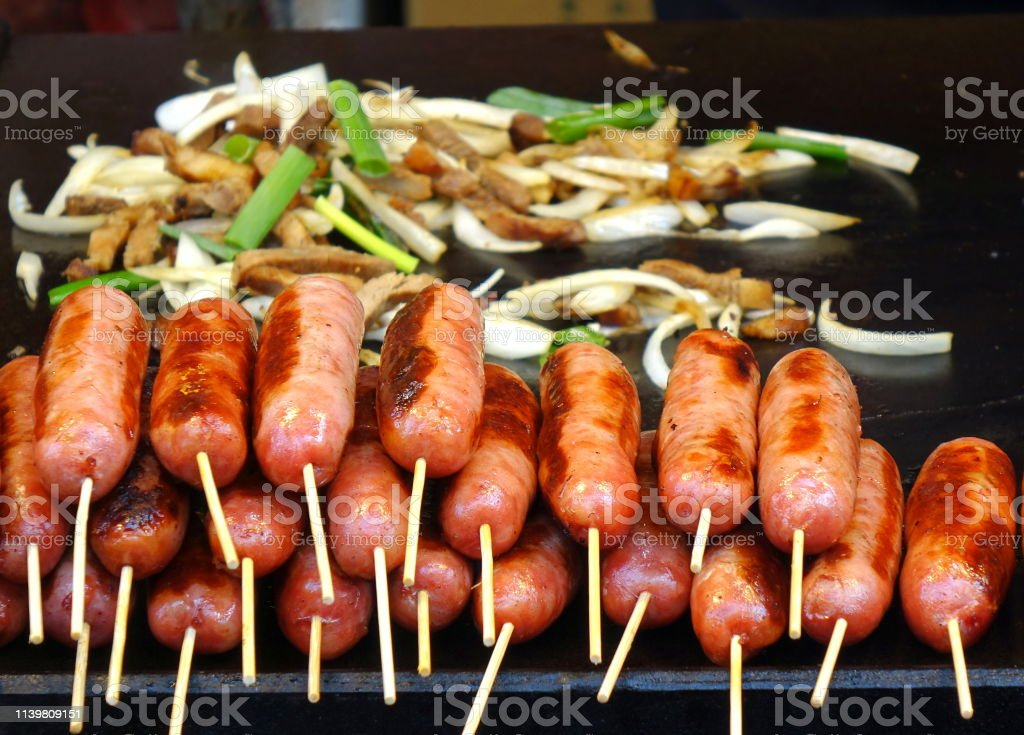 Grilled Sausages and Stir Fried Pork stock photo
