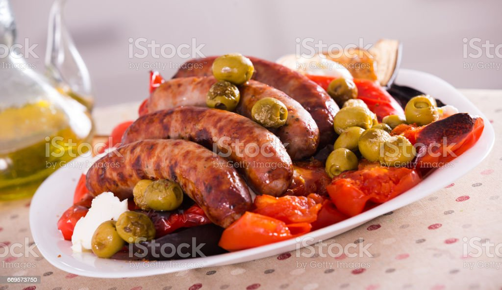Grilled sausages and vegetables stock photo