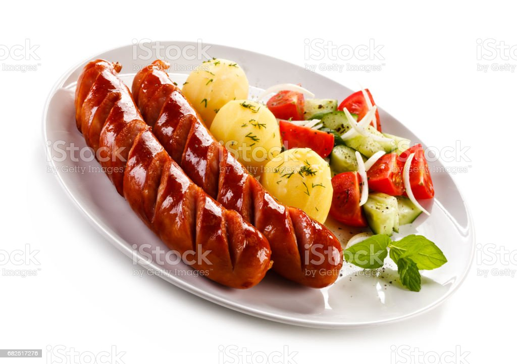 Grilled sausages and vegetables royalty-free stock photo