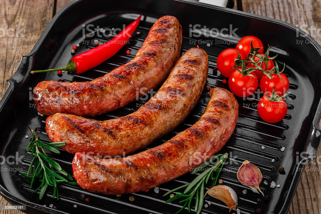 grilled sausages in a pan stock photo
