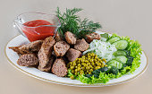 Grilled sausages with ketchup and dill
