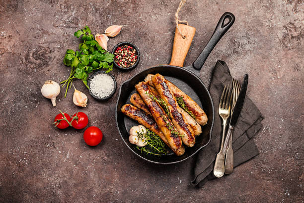 Grilled sausages with sauce stock photo