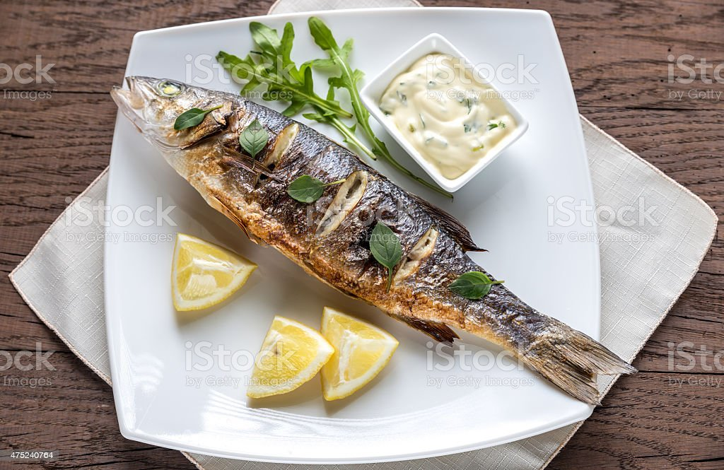 Grilled seabass on the plate stock photo