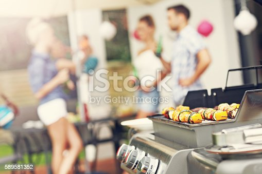 istock Grilled shashliks and hamburgers on grate 589581352