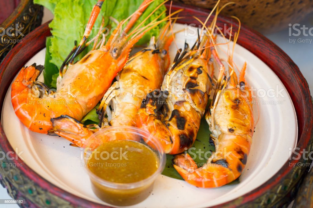 Grilled Shrimp and burn with seafood sauces , Thai food stock photo