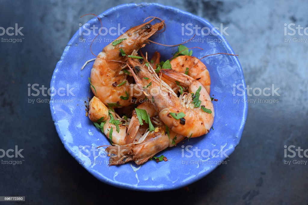 Grilled shrimp   on a blue plate stock photo