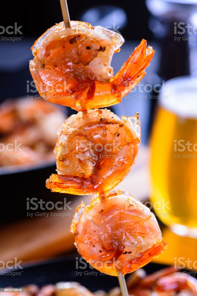 Grilled shrimp on bamboo skewers. Macro, closeup stock photo