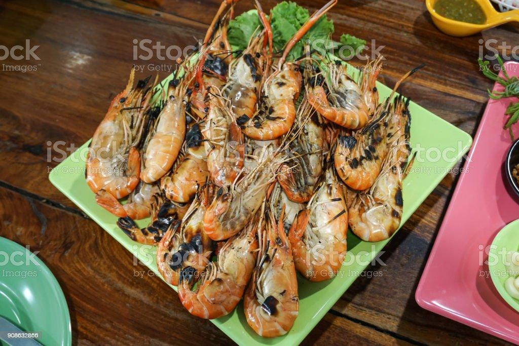 Grilled shrimp served on dish stock photo