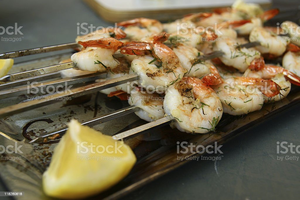 Grilled shrimp with lemon serving royalty-free stock photo