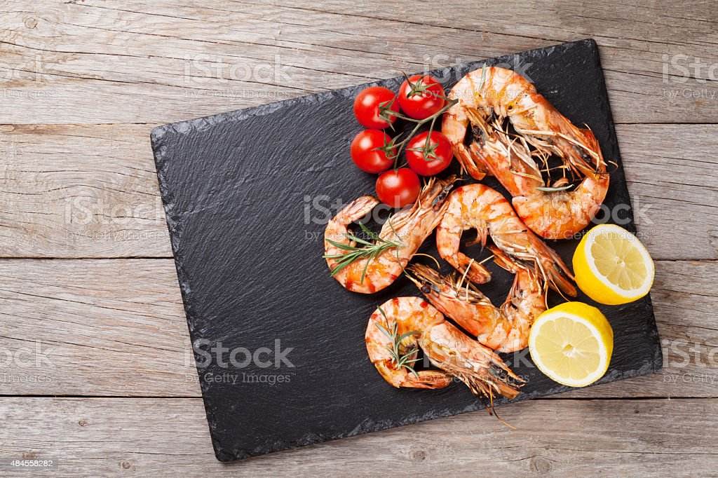 Grilled shrimps on stone plate stock photo