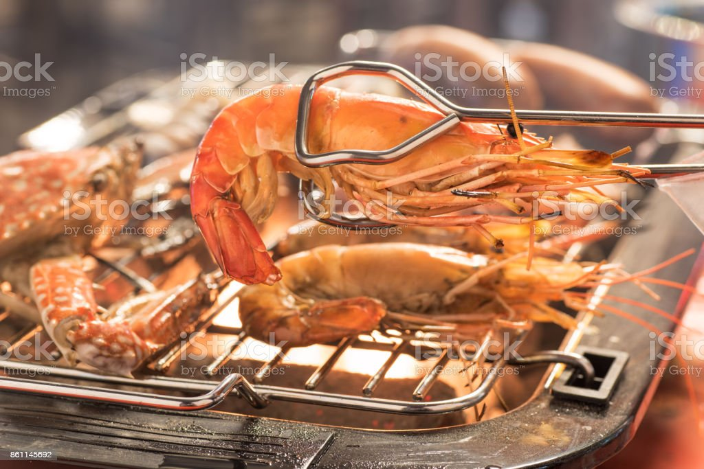 grilled shrimps on the flaming grill stock photo