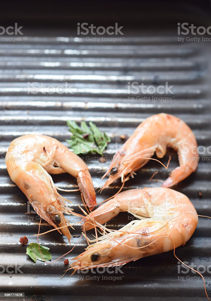 Grilled shrimps with red pepper and parsley stock photo