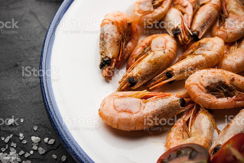Grilled  shrimps with salt on the ceramic plate stock photo