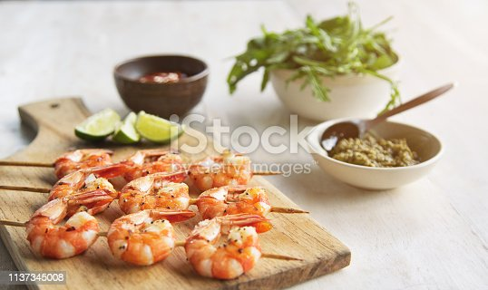Grilled shrimps on a skewer with seasoning and lime
