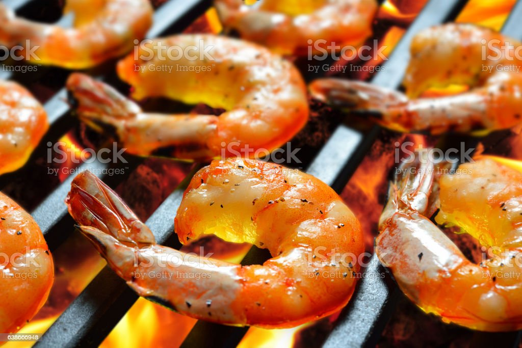 Grilled shrimps,prawns on the flaming grill stock photo