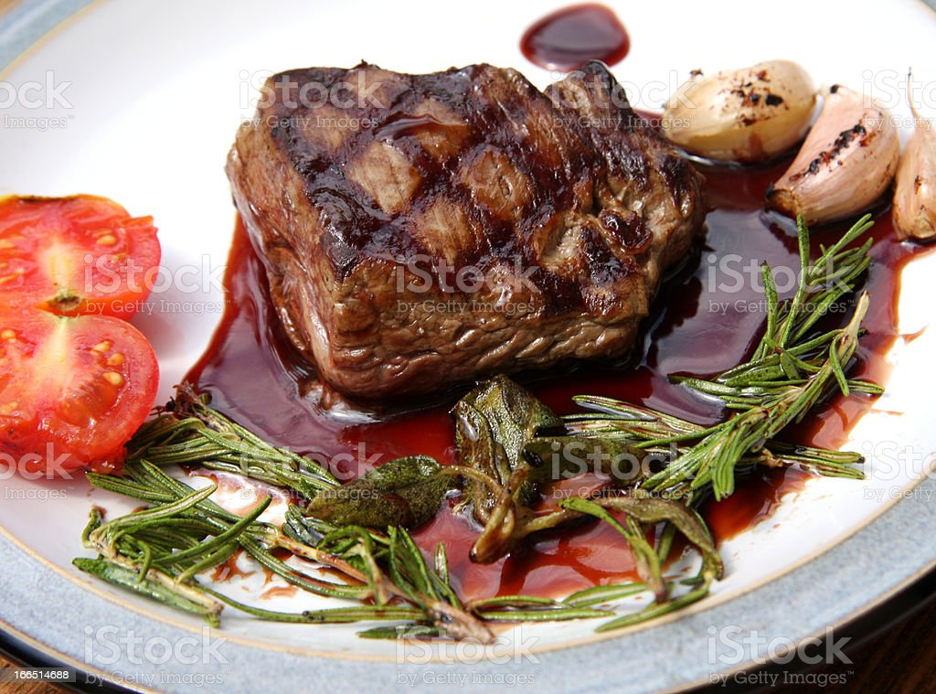 Grilled sirloin steak with herbs royalty-free stock photo