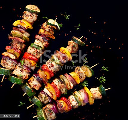 istock Grilled skewers of meat and vegetables 909772084