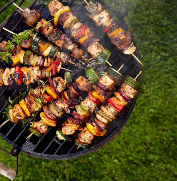 grilled skewers on a grilled plate - grilled vegetables stock photos and pictures