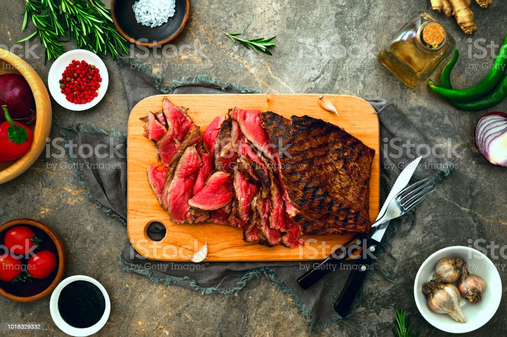 Grilled skirt steak served on a cutting board royalty-free stock photo