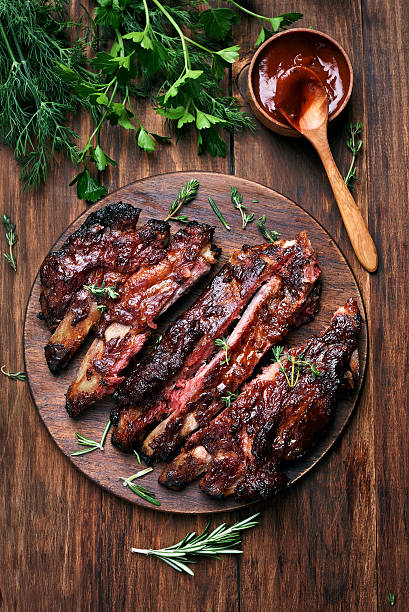grilled sliced barbecue pork ribs - ribs stock photos and pictures