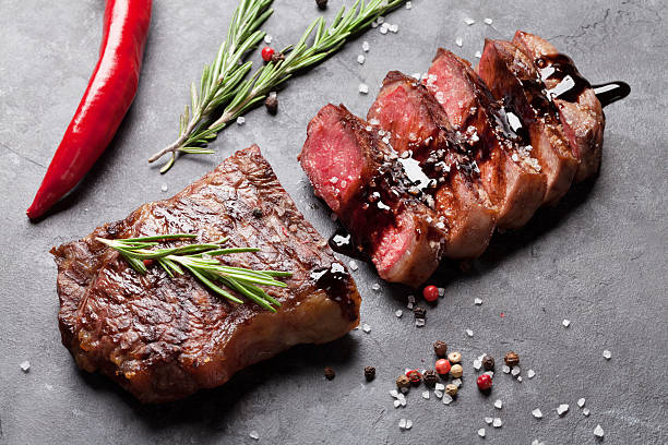 Grilled sliced beef steak Grilled sliced beef steak with balsamico and rosemary on stone table balsamic vinegar stock pictures, royalty-free photos & images
