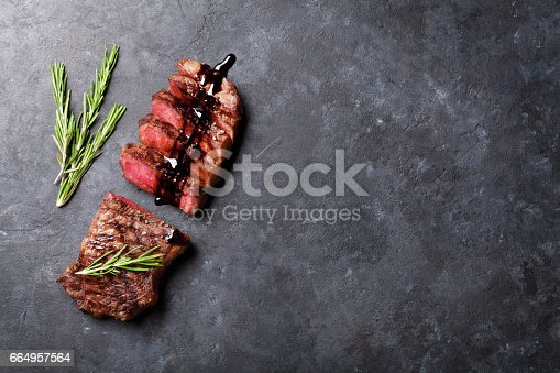 808351094istockphoto Grilled sliced beef steak 664957564