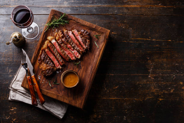 Grilled sliced Steak Rib eye with Pepper sauce stock photo