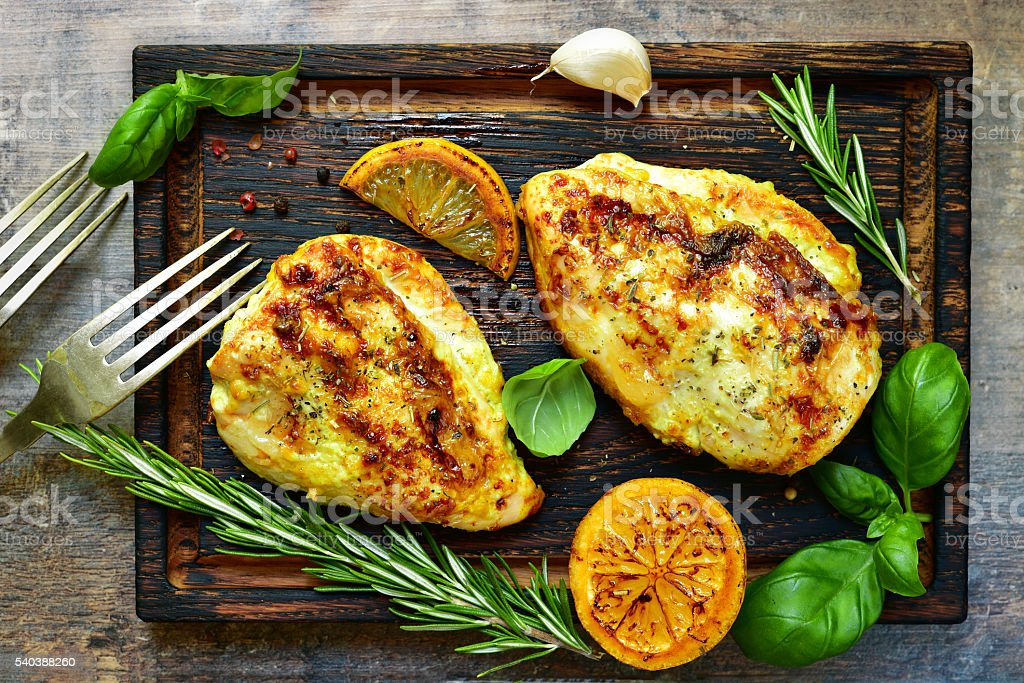 Grilled spicy chicken breast with herbs. stock photo