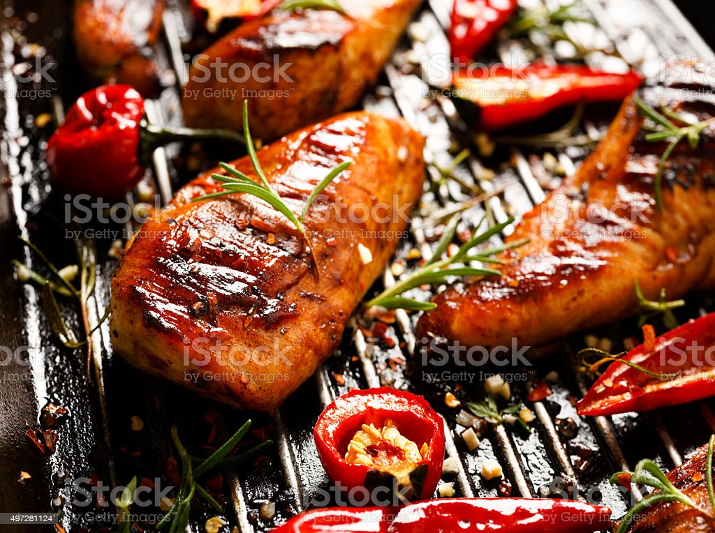 Grilled spicy fillets of chicken stock photo